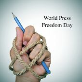 image of freedom speech  - the text world press freedom day and the hand of a man - JPG