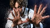 stock photo of sorcerer  - image of a man who performs magic with his hands - JPG