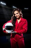 foto of karts  - Young girl racer with helmet at stadium - JPG