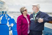 stock photo of passenger ship  - Happy Senior Couple Enjoying The View From Deck of a Luxury Passenger Cruise Ship - JPG