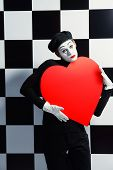 picture of mime  - Portrait of a male mime artist holds large red heart expressing love - JPG