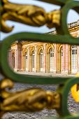 stock photo of versaille  - View at Grand Trianon Versailles through the fence - JPG