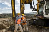 picture of piles  - Mechanic engineer shows drilling pile foundation - JPG