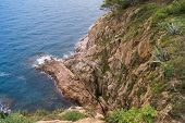 stock photo of descending  - the edge of the rocky shore steeply descending - JPG