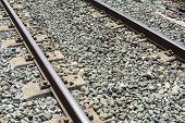 picture of train track  - Train tracks in a platform of station in a town - JPG