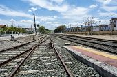 pic of train track  - Train tracks in a platform of station in a town - JPG