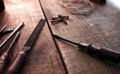 picture of work bench  - Old and well used tools on a aged wooden work bench - JPG