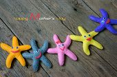 stock photo of special day  - Happy mothers day with i love you mom message idea from colorful fabric starfish on wooden background abstract wooden texture mother - JPG