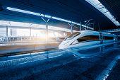 pic of high-speed train  - speeding train away from railway station - JPG