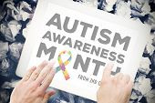 foto of autism  - autism awareness month against hands touching tablet screen - JPG