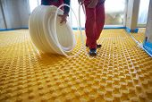 stock photo of convection  - group of workers installing underfloor heating and colling in modern home - JPG