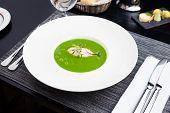 stock photo of scallops  - Broccoli cream soup with white fish and scallops - JPG