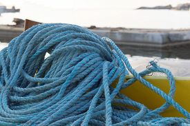 image of nylons  - Pile of blue nylon rope in the harbor - JPG