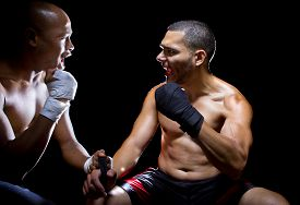 image of pep talk  - Trainer motivating a muscular Boxer or MMA fighter with pep talks - JPG