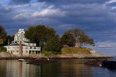 stock photo of marblehead  - dramatically lit house on the water - JPG