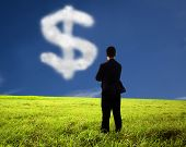 businessman watching the money cloud