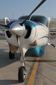 picture of cessna  - close up of a  cessna caravan parked on the runway with the one door open - JPG