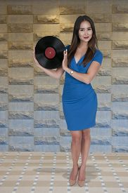 image of lps  - Beautiful woman with vintage record album lps - JPG