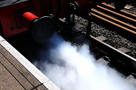 stock photo of steam  - Steam bellowing out of the front of a steam train alongside platform Brownhills West Railway Station Chasewater West Midlands England UK Western Europe - JPG
