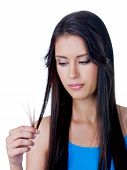 foto of split ends  - Disappointed young beautiful woman because of tangled long brown hair  - JPG