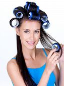 picture of femenine  - Portrait of happy beautiful woman in hairrollers  - JPG