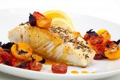 stock photo of halibut  - Pan fried halibut garnished with fennel seeds and spicy mustard sauce served with fried cherry tomatoes salad with purple basil - JPG