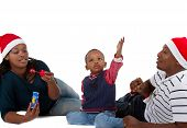 picture of christmas hat  - Young black family with a little boy are getting ready for christmas - JPG