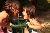 pic of drinking water  - Two little girls smiling and playing outdoors - JPG