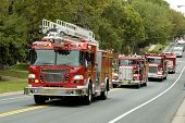 pic of mustering  - fire and rescue vehicles being driven in a fire muster parade - JPG