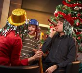 picture of nuclear family  - Happy family of three celebrating in new year eve hat at home - JPG