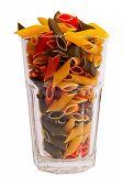 Glass full of colored italian pasta