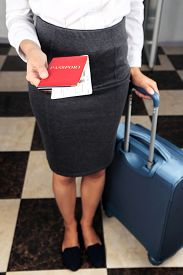 picture of passport cover  - Woman with suitcase holding passport  and tickets close up - JPG