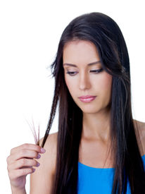 image of split ends  - Disappointed young beautiful woman because of tangled long brown hair  - JPG