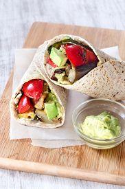 stock photo of takeaway  - Healthy vegetarian vegan takeaway wraps with roasted vegetables like aubergine eggplant - JPG