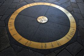 stock photo of wind-rose  - Ring in stone pavement in the middle of Bratislava - JPG