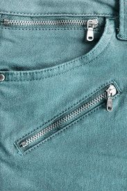 stock photo of zipper  - Blue jeans pocket with zippers as a background - JPG