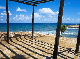 image of canopy roof  - Old wooden canopy on the sea coast and blue sky in Greece - JPG