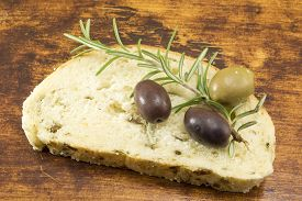 stock photo of fresh slice bread  - Olive bread slice with fresh olives and parsley - JPG