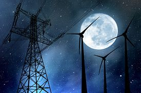 stock photo of electricity pylon  - Wind turbines and electricity pylon in the night sky with moon - JPG