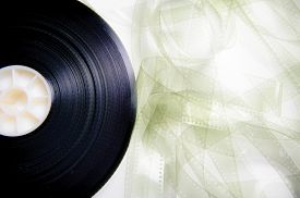 picture of mm  - 35 mm cinema film reel unrolled on white background - JPG