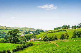 foto of farmhouse  - A sunny Summer view of English rural countryside surrounding a farmhouse - JPG