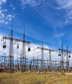 picture of substation  - distribution electric substation with power lines on a background of the summer sky - JPG