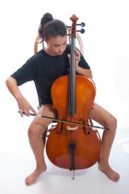 picture of cello  - Girl child warming up on her cello practice - JPG