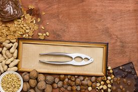 image of tong  - Set of various nuts with nut tongs - JPG