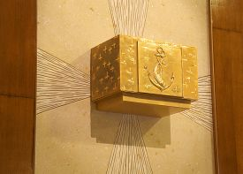 foto of tabernacle  - precious ancient Golden Tabernacle with Christian symbols in the Catholic Church - JPG