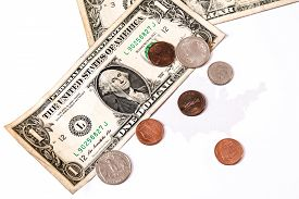 picture of two dollar bill  - dollar bills and cents over the united states map business symbol for whealth and gain over white - JPG