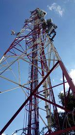 foto of telecommunications equipment  - Telecommunications tower against blue sky - JPG
