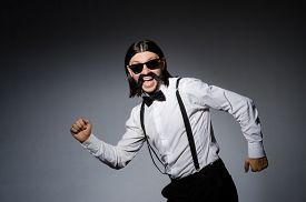 picture of moustache  - Man with moustache and sunglasses against gray - JPG
