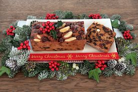 picture of greenery  - Genoa cake and slices with merry christmas ribbon - JPG
