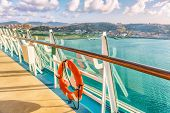 Cruise ship vacation travel Caribbean destination. View of island from boat balcony deck with railin poster